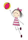 有球的逗人喜爱的小女孩 免版税库存照片