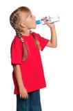 有瓶的小女孩水 免版税库存照片
