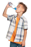 有瓶的男孩水 库存照片