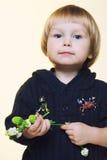 有瓷花的孩子 库存图片