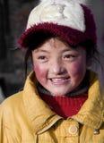有甜微笑的西藏女孩 库存照片