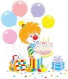 有生日蛋糕的马戏团小丑 免版税图库摄影