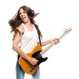 有电吉他的美丽的少妇 免版税库存照片