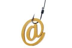 有电子邮件标志的一个钓鱼钩 图库摄影