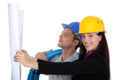 有电工的女性建筑师 免版税库存照片