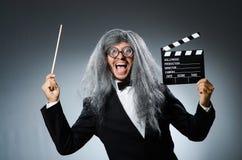 有电影墙板的滑稽的人 免版税图库摄影