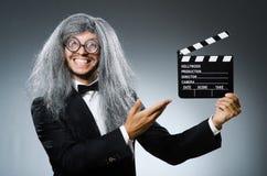 有电影墙板的滑稽的人 免版税库存照片