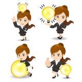 有电灯泡的女商人 库存照片
