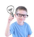 有电灯泡的聪明的男生 图库摄影