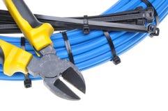 有电缆的钳子 免版税库存照片