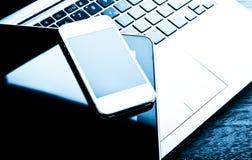有电话和片剂个人计算机的键盘 库存照片