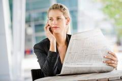 有电话和膝上型计算机的女实业家 库存照片