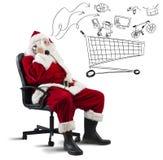 有电话的圣诞老人 免版税库存照片