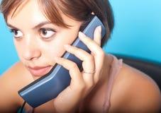 有电话的妇女 库存照片