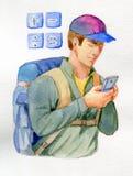 有电话的旅客 免版税库存照片