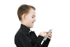 有电话的男孩 免版税图库摄影