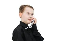 有电话的男孩 免版税库存照片