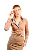 有电话的秀丽的妇女 免版税库存图片