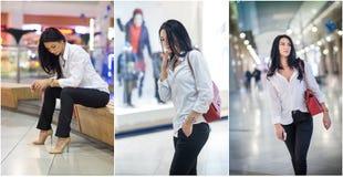 有男性白色摆在购物中心的衬衣和长裤的可爱的妇女 美丽的时兴的女孩坐长凳 免版税库存图片
