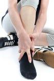 有痛苦的脚腕的妇女 库存图片