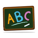 有白垩字母表的黑板 库存照片