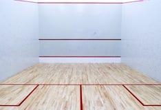 有白色墙壁的空的南瓜网球室 免版税库存图片