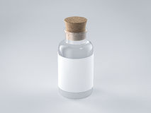 有白色标签的空的玻璃瓶 免版税库存图片
