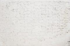 有白色油漆背景纹理的老砖墙 免版税库存照片