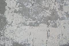 有白色破旧的油漆的老混凝土墙 免版税库存照片