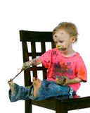 有的乐趣她自己绘画坐的小孩 免版税图库摄影