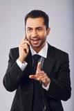 有的商人在电话的一次交谈 免版税库存图片