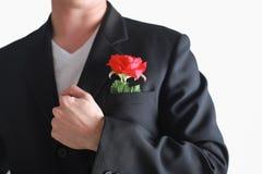 有的商人在白色背景隔绝的一朵红色玫瑰 val 图库摄影