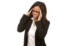 有的女商人头疼 免版税库存图片