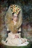 有的女孩在她的头的花 免版税库存图片