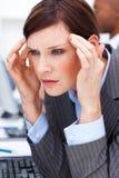 有的女实业家偏头痛年轻人 库存照片