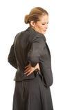 有的女实业家背部疼痛 库存照片