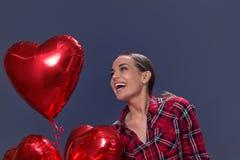 有的少妇心形的气球 日s华伦泰 库存图片