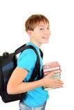 有的男小学生书 免版税库存图片