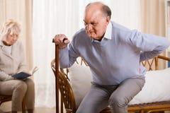 有的退休人员腰疼 库存照片