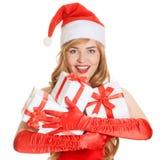 有的年轻愉快的xmas妇女礼物 免版税图库摄影