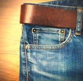 有皮带的牛仔裤 免版税库存照片