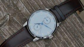 有皮带的豪华手表在黑背景 影视素材