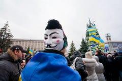有盖伊・福克斯面具的抗议者在peo人群  免版税库存照片