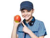 有盖帽和耳机的青少年的男孩 免版税库存照片
