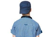 有盖帽和耳机的青少年的男孩 库存照片