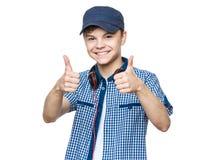 有盖帽和耳机的青少年的男孩 免版税图库摄影