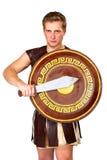 有盾的年轻男性战士 免版税库存照片