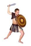 有盾的年轻男性战士 免版税库存图片