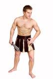 有盾的年轻男性战士 免版税图库摄影