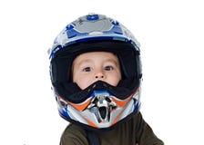 有看照相机的摩托车盔甲的孩子 免版税库存图片